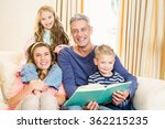 happy parents reading to their... | Shutterstock . vector #362215235
