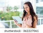 smiling woman using tablet by...   Shutterstock . vector #362227061