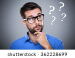 man thinking with question... | Shutterstock . vector #362228699