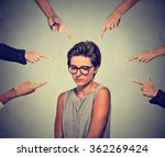 Stock photo concept of accusation guilty shy person girl sad embarrassed upset woman in glasses looking down 362269424