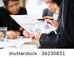 businesswoman examining graphs... | Shutterstock . vector #36230851