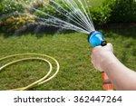 woman's hand with garden hose... | Shutterstock . vector #362447264