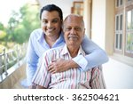 Small photo of Closeup portrait, family, young man in blue shirt holding older man in striped shirt from behind, happy isolated on outdoors outside balcony background