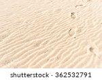 Footprint On The Beach Sand...