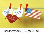 Small photo of White hearts USA ( America) flag hanging on colorful pegs ( clothespin ) on a line against a blue background. Concept - Martin Luther King Day. I have a dream collage. january 18