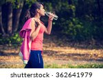 a girl drinks water after sport | Shutterstock . vector #362641979