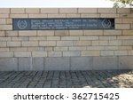 Small photo of VOLGOGRAD, RUSSIA - August 30, 2015: A concrete fence, with the poem on a granite plate, in the territory a military and memorial cemetery, Rossoshk's museum. Volgograd, Russia