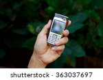 mobile phone in hand.   Shutterstock . vector #363037697