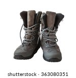 Pair of high warm gray boots on a white background - stock photo