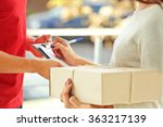 Small photo of Woman signing receipt of delivery package, close up