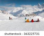 Snowboarders Sitting On A Ski...