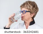 elderly woman drinks pure water ... | Shutterstock . vector #363242681