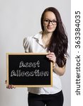 Small photo of Asset Allocation - Young businesswoman holding chalkboard - vertical image