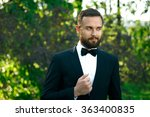 Small photo of bridegroom bewhiskered in a park in spring