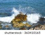Waves Breaking On The Rock