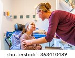 disabled child in a wheelchair... | Shutterstock . vector #363410489