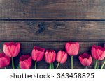 Row Of Tulips On Wooden...