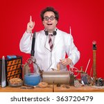 successful inventor at his desk ... | Shutterstock . vector #363720479