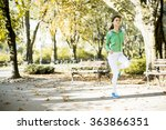 young woman running in the park | Shutterstock . vector #363866351