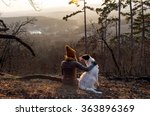 Stock photo girl sitting with dog in forest with beautiful view 363896369
