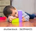 baby boy lying on the floor and ... | Shutterstock . vector #363946421