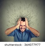 Small photo of Stressed man upset frustrated has too many thoughts with brain melting into lines question marks. Obsessive compulsive, adhd, anxiety disorder. Negative human emotions face expression feelings