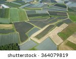 Small photo of fields and gardens covered with protective net. aerial photography. Germany, near Konstanz