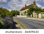 A Cottage By The Street In The...