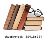 Old Books And Glasses On Book...
