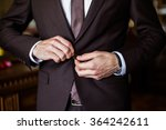 correct button on jacket  hands