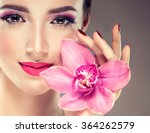 Girl With Flower Orchids In Hi...