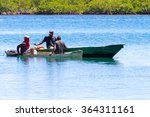 Small photo of ROATAN, HONDURAS - CIRCA JUNE 2006 - Fishermen work in their labor during a sunny day. Usually, they illegally poach in marine protected areas .