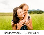 mother and child are hugging... | Shutterstock . vector #364419371