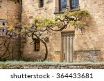 Old Stone House With A Wisteri...