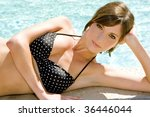 beautiful young woman at a pool   Shutterstock . vector #36446044