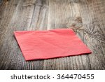 red paper napkin on wooden table | Shutterstock . vector #364470455