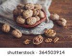 walnuts on dark wooden... | Shutterstock . vector #364503914