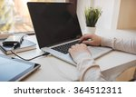young woman working on laptop  | Shutterstock . vector #364512311