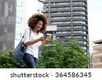 portrait of young woman walking ...   Shutterstock . vector #364586345