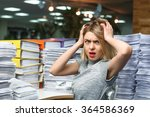 Small photo of Office businesswoman at her desk full of documents, showing an overwhelmed expression