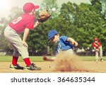 boy sliding into base during a... | Shutterstock . vector #364635344