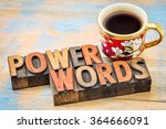 Small photo of power words - text in vintage letterpress wood type printing blocks against painted wood with a cup of coffee
