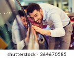 happy man touching car in auto... | Shutterstock . vector #364670585