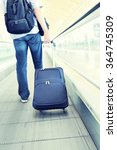traveler with a suitcase on the ... | Shutterstock . vector #364745309