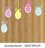 colored easter eggs hanging on...