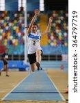 Small photo of ISTANBUL, TURKEY - DECEMBER 12, 2015: Athlete Aybuke Karatas long jumpes during Turkish Athletic Federation Olympic Threshold Indoor Competitions