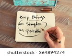 Stock photo retro effect and toned image of a woman hand writing a note with a fountain pen on a notebook 364894274
