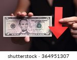 Small photo of US Dollar with a red arrow to imply the fall or devaluation of US dollar currencies.