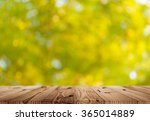 wood top table on sunlight... | Shutterstock . vector #365014889