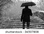 Man With A Umbrella Walks...